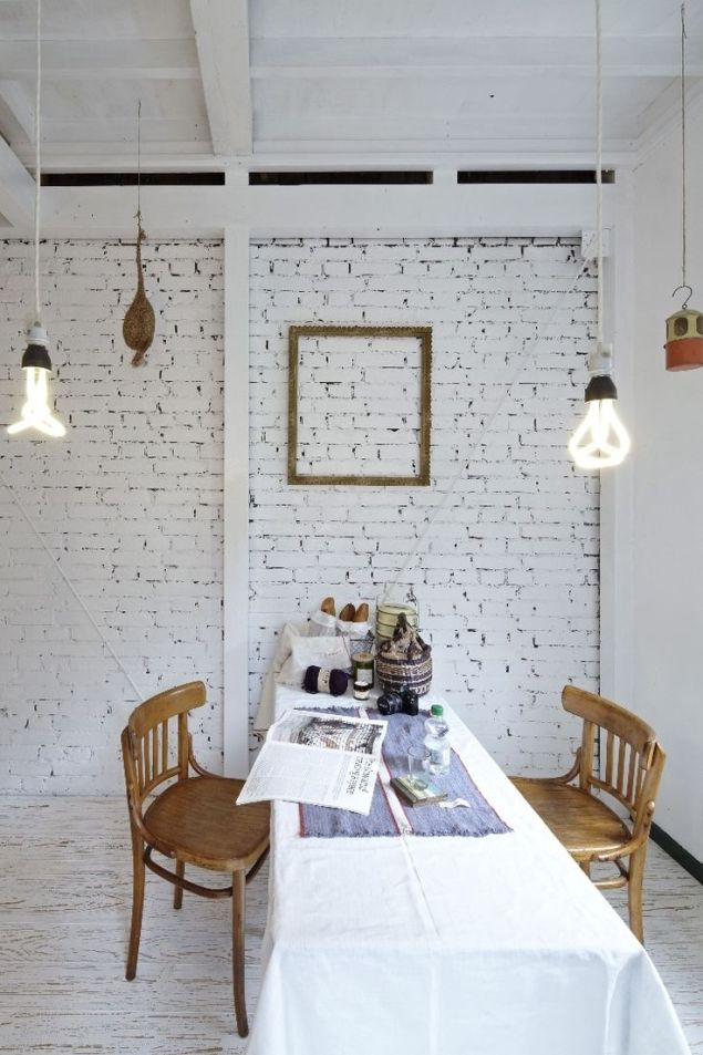 dining-room-featuring-white-bricks